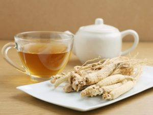 Photo of ginseng tea and root.