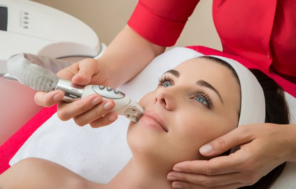 Women getting laser skin treatments done