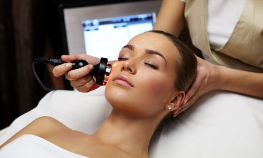 Woman lies on a table in a beauty spa getting a cosmetic procedure done for medical travel