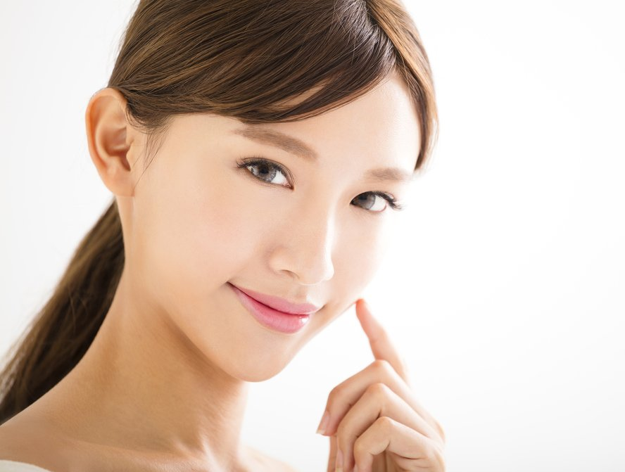 closeup beautiful young asian woman face touching youthful face