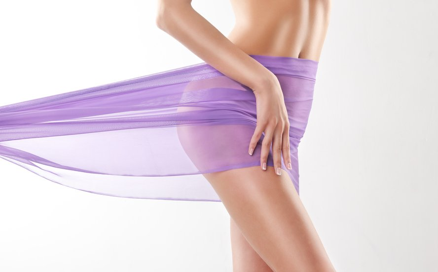 Slim toned body with purple scarf after vaginoplasty surgery