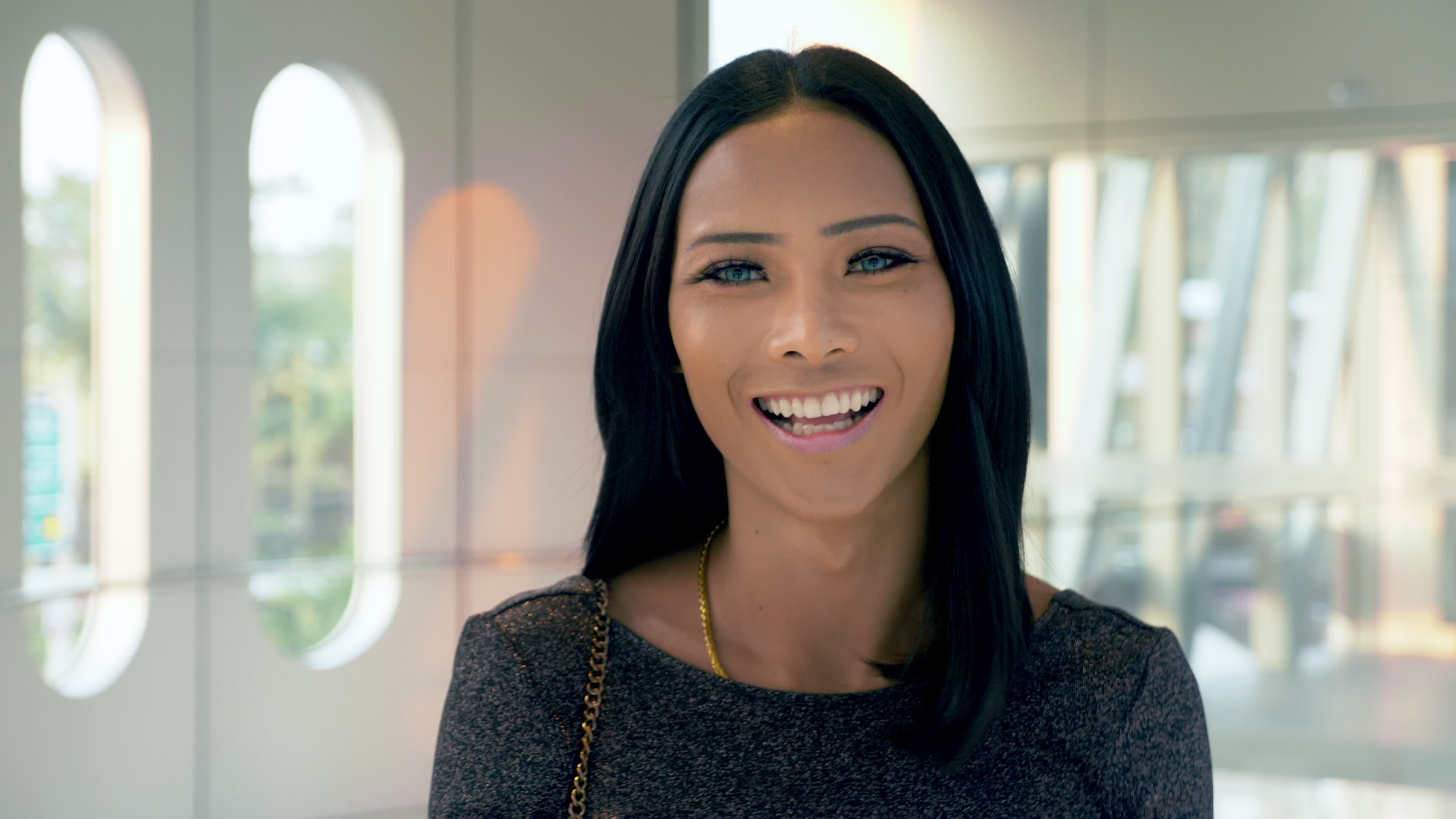 Woman looking at camera smiling for special cosmetic procedures