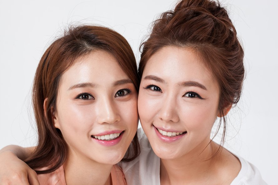 Two women smiling after cosmetic dental surgery