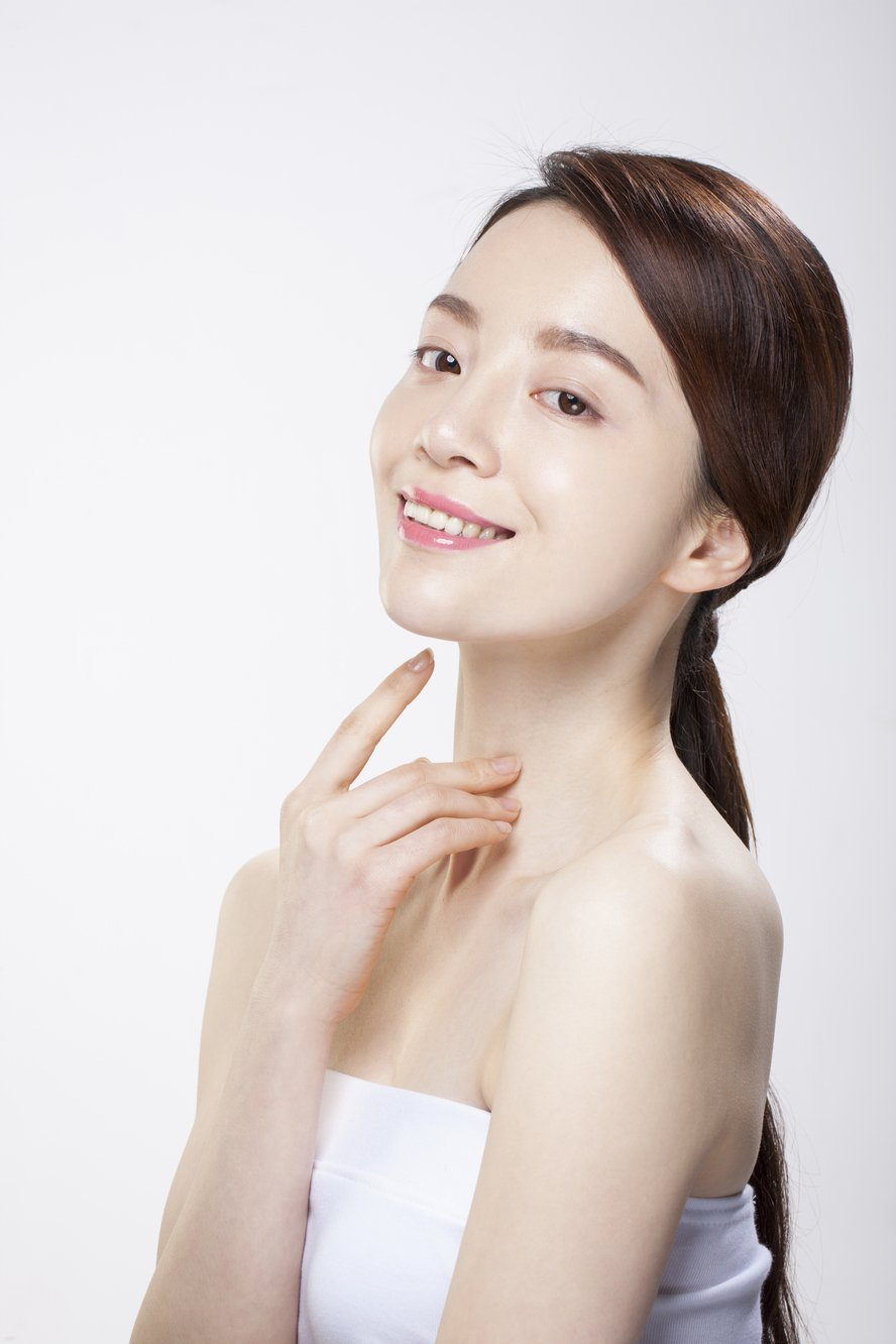 woman looking at camera with arm under chin after nose surgery korea