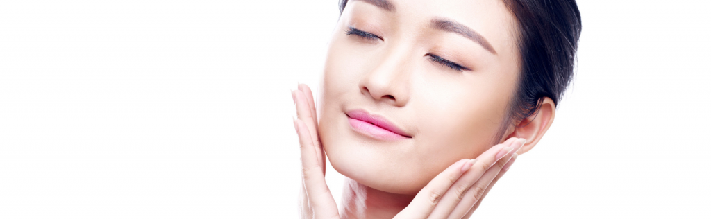 woman patting face for korean 10 step skin care