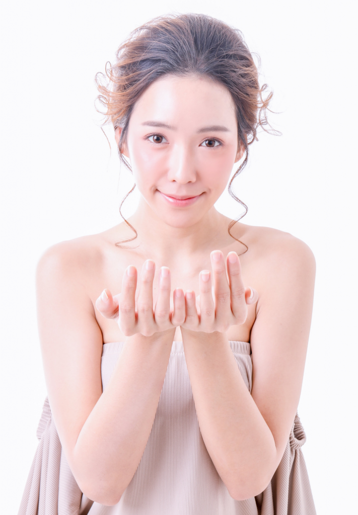 Woman with cupped hands for korean 10 step skin care