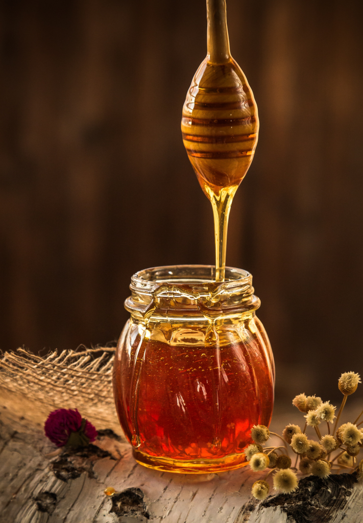 Honey in  clear jar for natural skin care ingredients